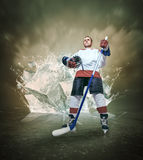 Hockey player portrait on abstract ice background Royalty Free Stock Photos