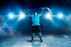 Hockey player raised his hands up, winner royalty free stock photo