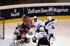 Hockey player running into goalie Royalty Free Stock Photo