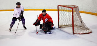 Hockey player scores. Ice hockey player shoots and scores stock images