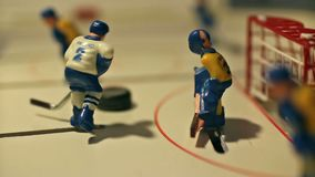 Hockey player scores the puck. Hockey board game Close to