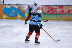 Hockey player shoots the puck and attacks.  stock image