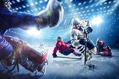 Hockey players shoots the puck and attacks. Hockey player shoots the puck and attacks royalty free stock photos