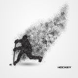 Hockey player of a silhouette from particle. Stock Images