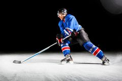Hockey player turning around skating on ice Royalty Free Stock Images