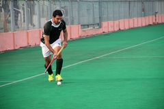 Hockey Player Tackling Ball. SIALKOT, PAKISTAN - DECEMBER 2014: All Pakistan Annual Field Hockey Tournament Between PIA and PAF Teams at Sialkot International Stock Image