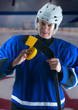 Hockey player taping his stick Stock Photo