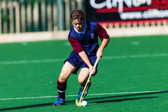 Hockey Player Westville Schools Playing Astro. Hockey Westville Player with focus on ball possession at the under sixteen years age group game between Clifton royalty free stock image
