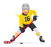Hockey player in yellow uniform Royalty Free Stock Image