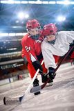 Hockey players in action. Children playing hockey on ice stock photo
