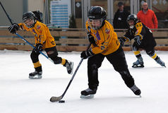 Hockey players in action with puck. BELGRADE-JANUARY 8.NEW YEAR'S ICE HOCKEY TOURNAMENT FOR CHILDREN AGED EIGHT YEARS.Hockey players in action with puck.JANUARY Stock Image