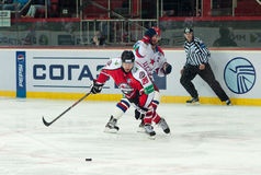 Hockey players of CSKA (Moscow) and the Donbass (Donetsk) fight for the puck Royalty Free Stock Photography