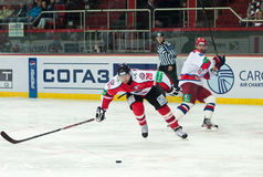 Hockey players of CSKA (Moscow) and the Donbass (Donetsk) fight for the puck Royalty Free Stock Images