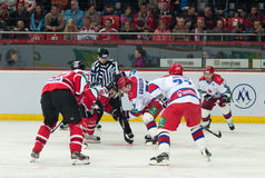 Hockey players of CSKA (Moscow) and the Donbass (Donetsk) fight for the puck. Donetsk SEPTEMBER 10: Ice hockey, the game of Ukraine and Russia Stock Image