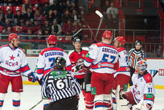 Hockey players of CSKA (Moscow) and the Donbass (Donetsk) fight for the puck. Donetsk SEPTEMBER 10: Ice hockey, the game of Ukraine and Russia Royalty Free Stock Photo