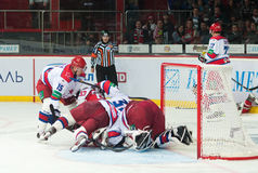 Hockey players of CSKA (Moscow) and the Donbass (Donetsk) fight for the puck. Donetsk SEPTEMBER 10: Ice hockey, the game of Ukraine and Russia Stock Photo