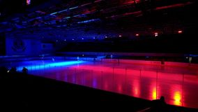 Hockey players go on the ice arena before the match stock video footage
