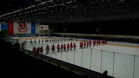 Hockey players go on the ice arena before the match stock video