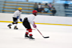 Hockey Players On the Ice. Abstract motion blur of two hockey players skating down the ice rink Royalty Free Stock Photography