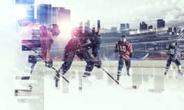 Hockey players on ice . Mixed media royalty free stock image