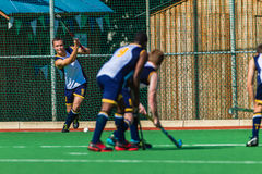 Hockey Players Short Corner. Hockey Players playing a short corner play. Glenwood boys plays DHS at the Riverside astro  in Durban South-Africa Royalty Free Stock Photo
