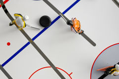 Hockey players and puck. Toy hockey game, with two players and puck from above Stock Images