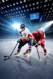 Hockey players shoots the puck and attacks stock photos