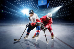 Hockey players shoots the puck and attacks royalty free stock images