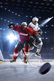 Hockey players shoots the puck and attacks Royalty Free Stock Photos