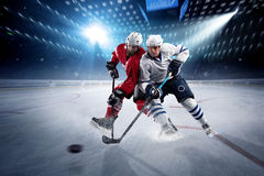 Free Hockey Players Shoots The Puck And Attacks Stock Photo - 67356470