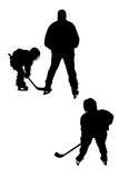 Hockey players silhouettes Royalty Free Stock Image