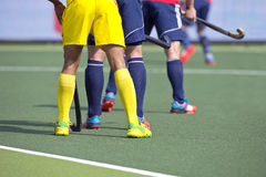 Hockey players. From two different teams guarding during a match on an artificial grass pitch Royalty Free Stock Photography