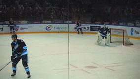 Hockey players in the warm-up stock video
