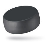 A hockey puck. The hockey puck isolated on white Royalty Free Stock Image