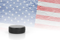 Hockey puck and the American flag Royalty Free Stock Images