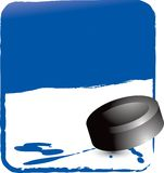 Hockey puck on blue background Royalty Free Stock Photos