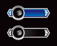 Hockey puck on blue and black arrow banners Royalty Free Stock Photos