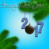 Hockey puck and 2017 on a Christmas tree branch. Happy New Year and numbers 2017 and soccer ball as a Christmas decorations hanging on a Christmas tree branch Stock Photos