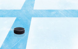 Hockey Puck and Finland Flag on Ice With Copy Space Royalty Free Stock Image