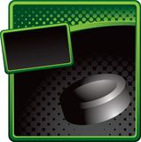 Hockey puck on green and black halftone ad Royalty Free Stock Photography