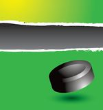 Hockey puck on green ripped banner Royalty Free Stock Photos