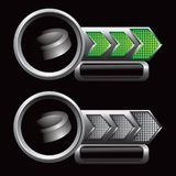 Hockey puck on green and silver checkered arrows Royalty Free Stock Photo