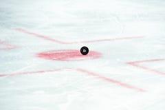 Hockey puck on hockey game Stock Image