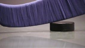 Hockey puck and hockey stick stock footage