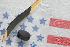 Hockey puck, hockey sticks and ice rink Royalty Free Stock Photo