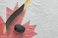 Hockey puck, hockey sticks and ice rink Royalty Free Stock Image