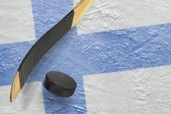 Hockey puck, hockey sticks and ice rink Stock Photos