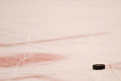Hockey Puck on the Ice royalty free stock images
