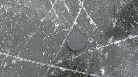 Hockey puck on ice stock photography