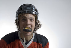 Hockey Puck in Mouth - Horizontal Royalty Free Stock Photo